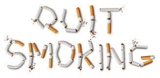 Quit smoking. Text quit smoking made from broken cigarettes Royalty Free Stock Photo