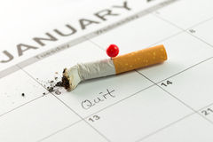 Quit smoking. Time to quit smoking concept using cigarette on calendar Royalty Free Stock Image