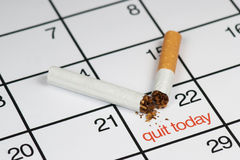 Quit smoking today. A broken cigarette above a calendar, saying quit today Stock Images
