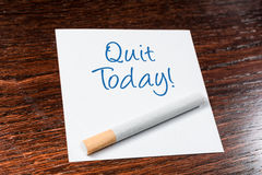 Quit Smoking Today Reminder With Cigarette On Wooden Shelf Royalty Free Stock Photos