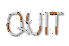 Quit smoking. Word written with broken cigarette concept for quitting smoking Royalty Free Stock Photo