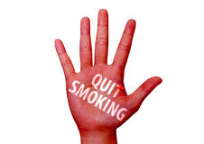 Quit smoking written on woman hand Stock Photos