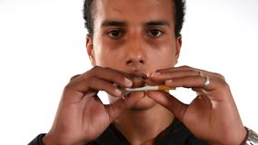 Quit smoking. Young man breaking a cigarette. stock video footage