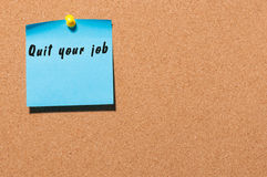 Quit your job - motivate inscription on blue sticker pinned at cork notice board. With empty space for text Royalty Free Stock Images
