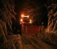 Quitanieves de la noche Foto de archivo libre de regalías