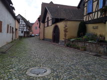 Quite afternoon alley. Sightseeing I came to this beautiful location in Alsace, France Stock Photo