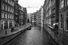 Quite canal in Amsterdam Netherlands. Amsterdam's name derives from Amstelredamme,[14] indicative of the city's origin as a dam of the river Amstel. Originating Stock Photo