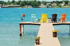 Quite dock with colorful chairs and decorations Royalty Free Stock Images