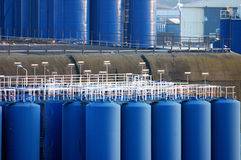 Blue industry. Quite a lot of blue storage tanks at the dock of Ijmuiden nearby Amsterdam Stock Photography