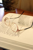 Quite Reading Lounge with Book and Glasses. Reading Lounge with Book and Glasses - tranquil setting Royalty Free Stock Photo