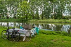 2 bicycles and picnic table Stock Photo