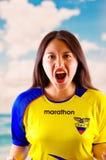 QUITO, ECUADOR -8 OCTOBER, 2016: Young ecuadorian woman wearing official Marathon football shirt standing facing camera Stock Images