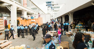Quito, Ecuador - April,23, 2016: Bags of supplies for disaster relief with food, clothes, medicine and water for Royalty Free Stock Images