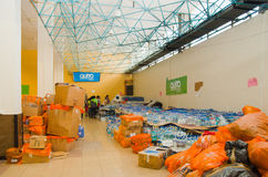 Quito, Ecuador - April,23, 2016: Bags of supplies for disaster relief with food, clothes, medicine and water for Royalty Free Stock Image