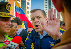 Quito, Ecuador - April 7, 2016: Closeup opposition leader Andres Paez sorrounded by people, police and journalists during anti gov Stock Images