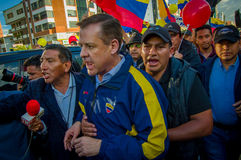 Quito, Ecuador - April 7, 2016: Closeup opposition leader Andres Paez surrounded by people, police and journalists Royalty Free Stock Image