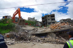 Quito, Ecuador - April,17, 2016: House destroyed by Earthquake with rescuers and heavy machinery in the south part of Royalty Free Stock Images