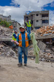 Quito, Ecuador - April,17, 2016: House destroyed by Earthquake with rescuers and heavy machinery in the south part of Royalty Free Stock Photo