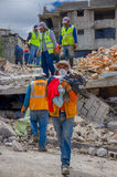 Quito, Ecuador - April,17, 2016: House destroyed by Earthquake with rescuers and heavy machinery in the south part of Stock Images