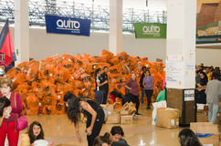 Quito, Ecuador - April 23, 2016: Unidentified citizens of Quito providing disaster relief food, clothes, medicine and Stock Photography