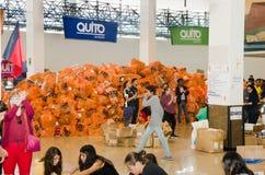 Quito, Ecuador - April 23, 2016: Unidentified citizens of Quito providing disaster relief food, clothes, medicine and Royalty Free Stock Photos