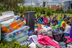 Quito, Ecuador - April,17, 2016: Unidentified citizens of Quito providing disaster relief food, clothes, medicine and water for ea Stock Photo