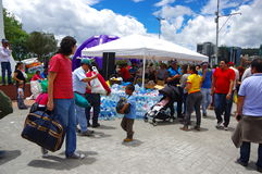 Quito, Ecuador - April,17, 2016: Unidentified citizens of Quito providing disaster relief food, clothes, medicine and water for ea Stock Photos