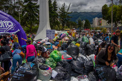 Quito, Ecuador - April,17, 2016: Unidentified citizens of Quito providing disaster relief food, clothes, medicine and water for ea Stock Photography