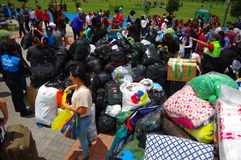 Quito, Ecuador - April,17, 2016: Unidentified citizens of Quito providing disaster relief food, clothes, medicine and Stock Image