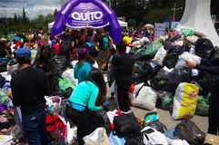 Quito, Ecuador - April,17, 2016: Unidentified citizens of Quito providing disaster relief food, clothes, medicine and Royalty Free Stock Photo