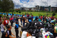 Quito, Ecuador - April,17, 2016: Unidentified citizens of Quito providing disaster relief food, clothes, medicine and Royalty Free Stock Photography