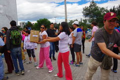 Quito, Ecuador - April,17, 2016: Unidentified citizens of Quito providing disaster relief food, clothes, medicine and Royalty Free Stock Photos