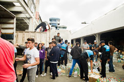 Quito, Ecuador - April,23, 2016: Unidentified citizens of Quito providing disaster relief food, clothes, medicine and Royalty Free Stock Images