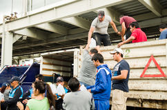 Quito, Ecuador - April,23, 2016: Unidentified citizens of Quito providing disaster relief food, clothes, medicine and Stock Photo