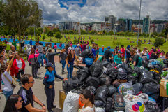 Quito, Ecuador - April,17, 2016: Unidentified citizens of Quito providing disaster relief food, clothes, medicine and Royalty Free Stock Images