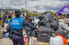 Quito, Ecuador - April,17, 2016: Unidentified citizens of Quito providing disaster relief food, clothes, medicine and Stock Photos