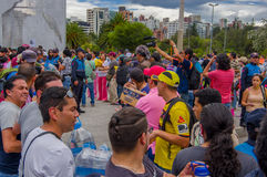 Quito, Ecuador - April,17, 2016: Unidentified citizens of Quito providing disaster relief food, clothes, medicine and Stock Photography