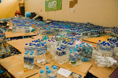 Quito, Ecuador - April 23, 2016: Water donated by citizens of Quito providing disaster relief for earthquake survivors Royalty Free Stock Image