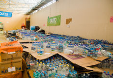 Quito, Ecuador - April 23, 2016: Water donated by citizens of Quito providing disaster relief for earthquake survivors Stock Photos