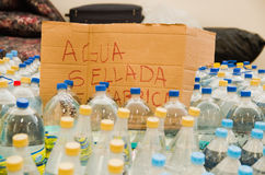 Quito, Ecuador - April 23, 2016: Water donated by citizens of Quito providing disaster relief for earthquake survivors Royalty Free Stock Photo