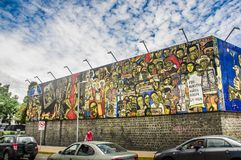 QUITO, ECUADOR AUGUST 20 2017: Beautiful mural graffiti on a wall with some cars parked in central Quito, Ecuador Stock Images