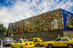 QUITO, ECUADOR AUGUST 20 2017: Beautiful mural graffiti on a wall with some cars parked in central Quito, Ecuador Stock Image