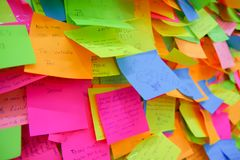 QUITO, ECUADOR - AUGUST 24, 2018: Close up of selective focus of exposition of set of colorful paper notes in a wall, in. The city of Quito, Ecuador royalty free stock photo