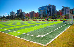 QUITO, ECUADOR - 8 AUGUST, 2016: Football fields located in inner city park La Carolina, artificial green grass surface, buildings Royalty Free Stock Photography