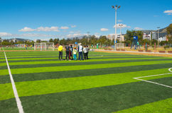 QUITO, ECUADOR - 8 AUGUST, 2016: Group of people standing on football field located in inner city park La Carolina, artificial gre Royalty Free Stock Photos