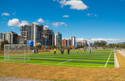 QUITO, ECUADOR - 8 AUGUST, 2016: Group of people standing on football field located in inner city park La Carolina, artificial gre Royalty Free Stock Image