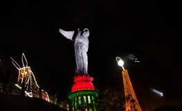 QUITO, ECUADOR - AUGUST 8, 2014: La Virgen de El Panecillo statue in the city center photographed at night Quito is an Stock Photos