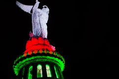 QUITO, ECUADOR - AUGUST 8, 2014: La Virgen de El Panecillo statue in the city center photographed at night view from Royalty Free Stock Images