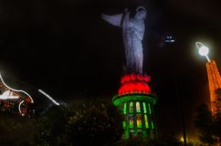 QUITO, ECUADOR - AUGUST 8, 2014: La Virgen de El Panecillo statue in the city center photographed at night view from Royalty Free Stock Image