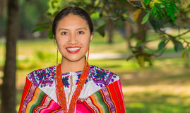 QUITO, ECUADOR - AUGUST, 30 2017: Unidentified young indigenous woman wearing a typical andean clothes, covering her. Shoulder with a colorful blanket in the Royalty Free Stock Photo